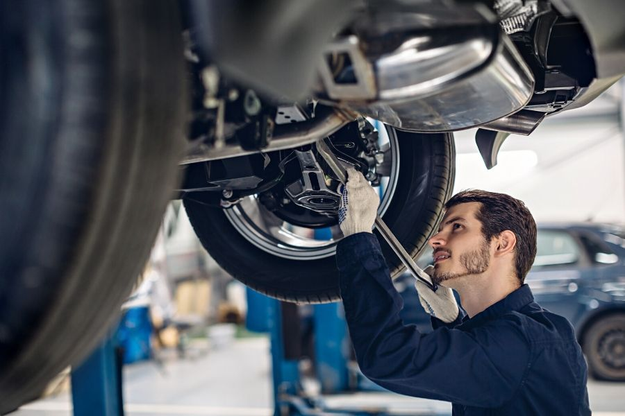 professional worker is fixing the car in vancouver auto body shop